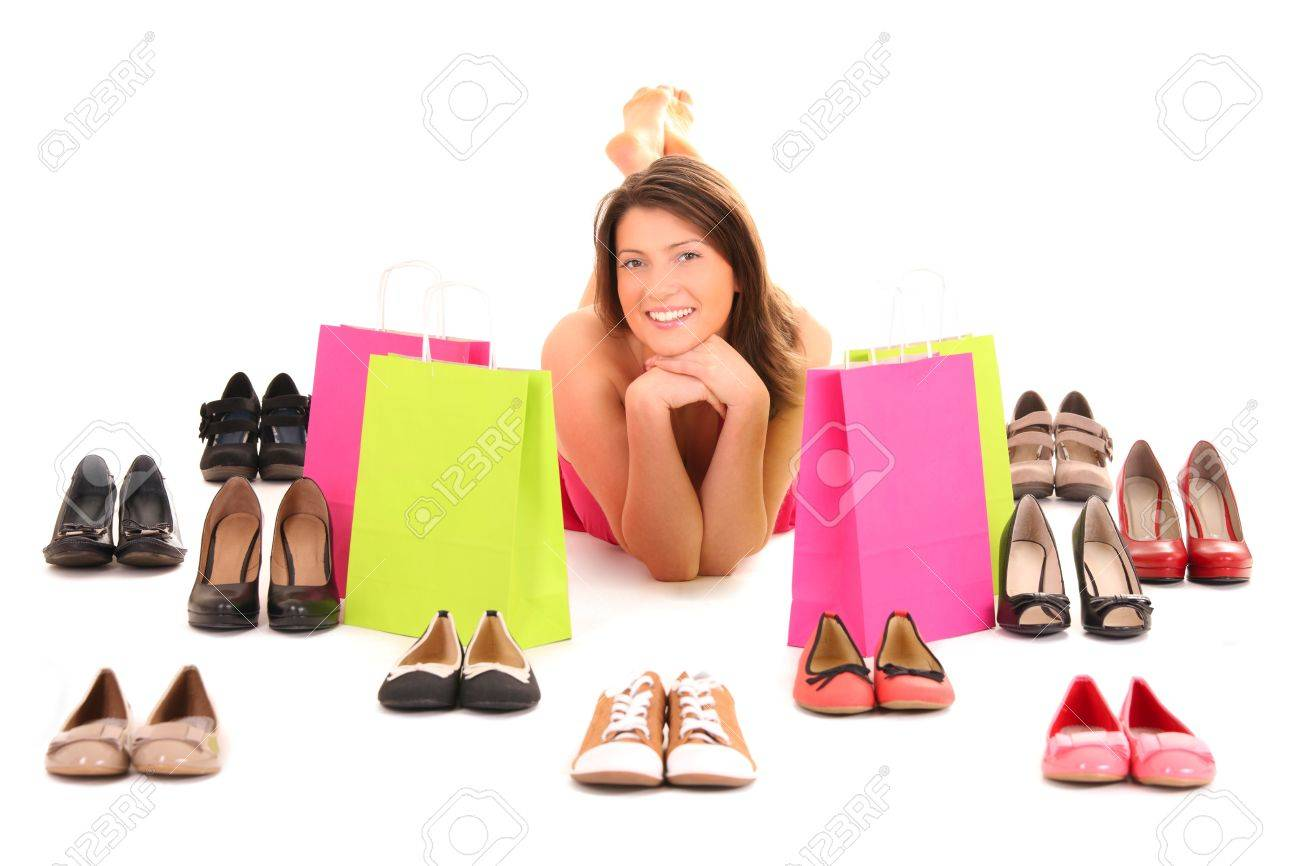 A picture of a pretty young woman lying among shoes over white background Stock Photo - 12612329