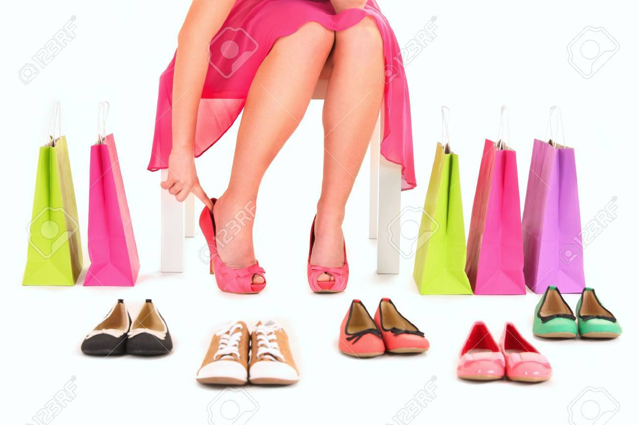 A picture of a young woman trying on new pair of heels over white background Stock Photo - 12612308