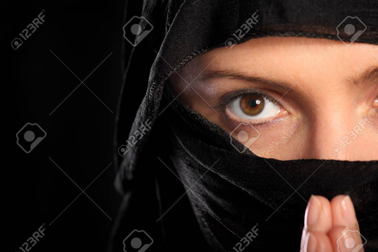 A picture of a young arabic woman focused on her prayer over black background Stock Photo - 12911266