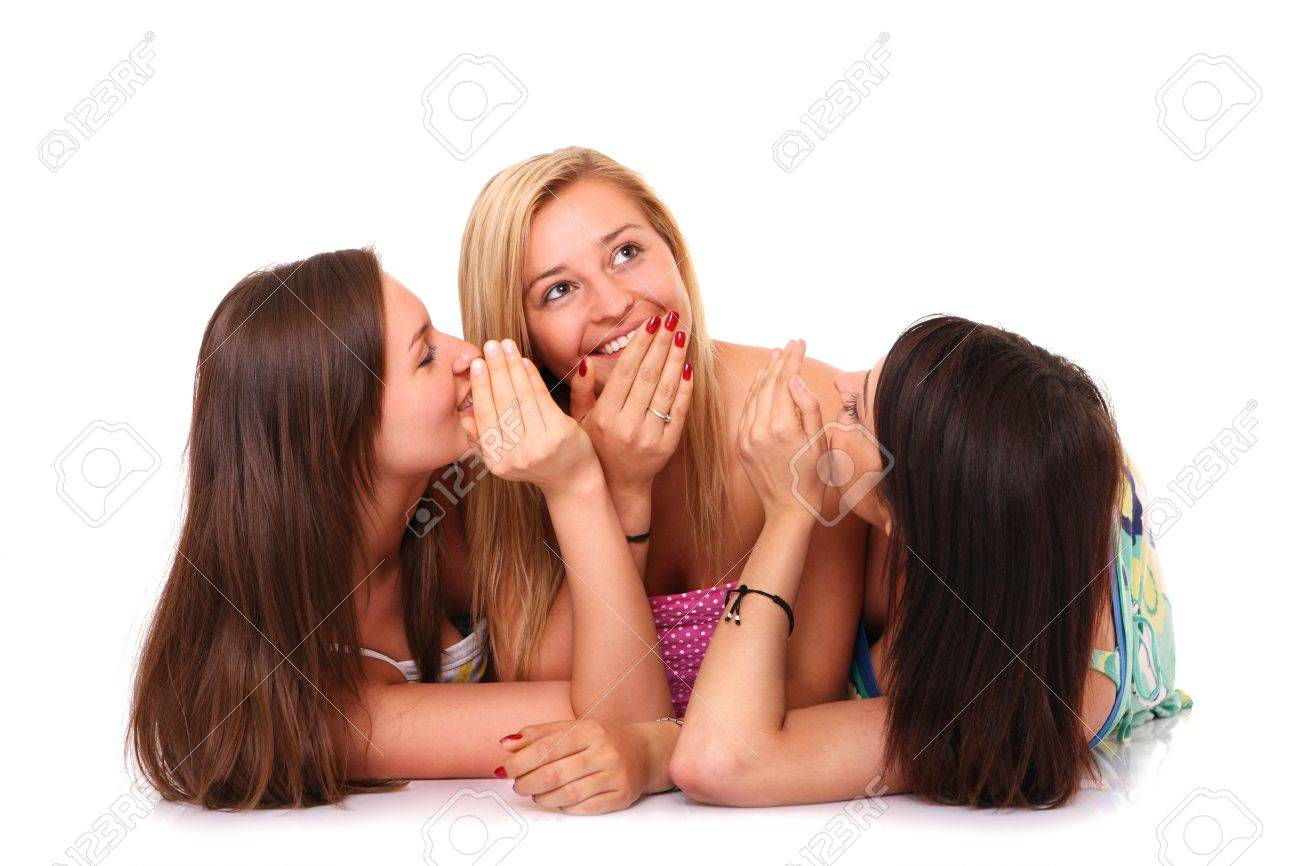 A picture of three girlfriends gossiping over white background Stock Photo - 13877474