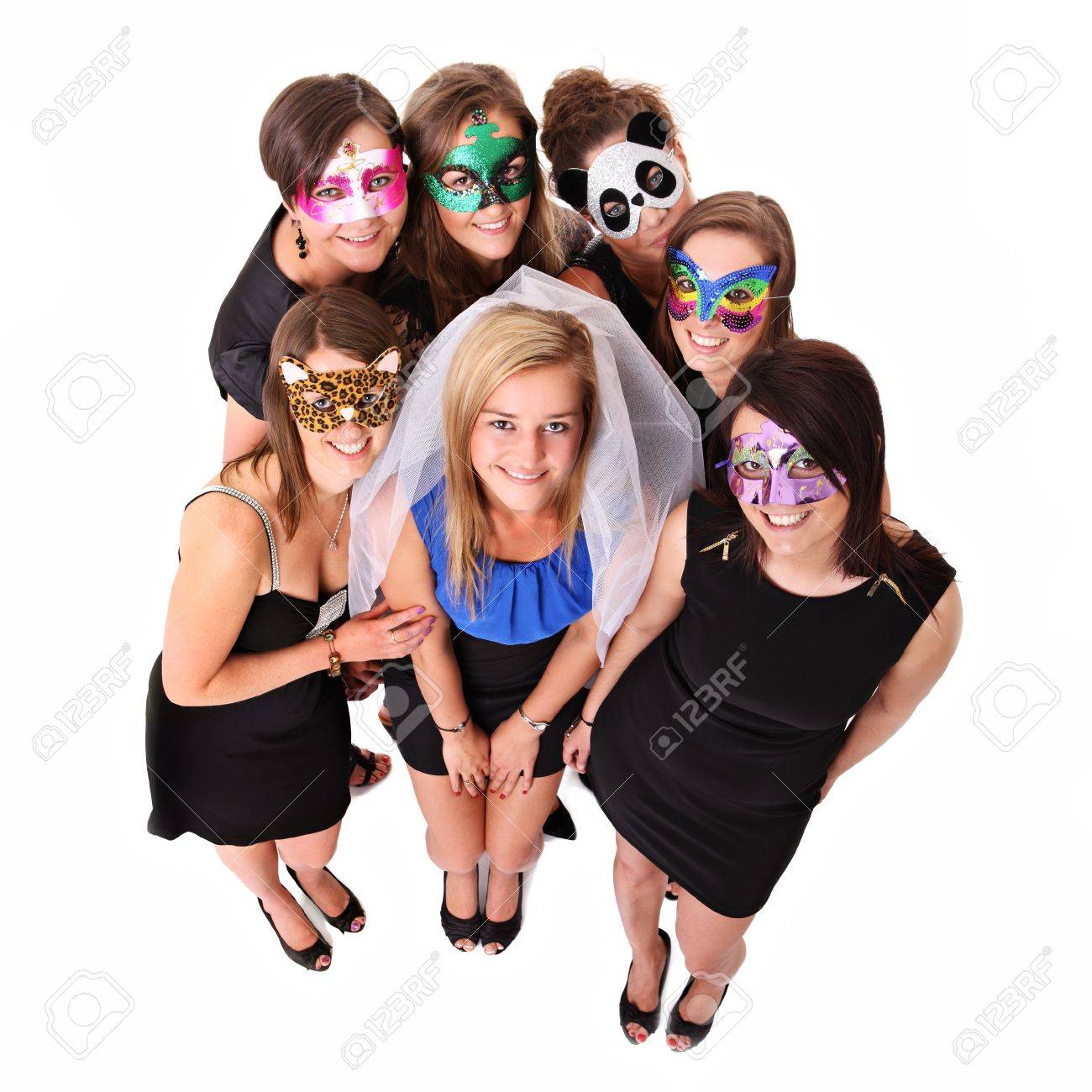 A portrait of seven girlfriends in carnival masks smiling over white background Stock Photo - 13910684