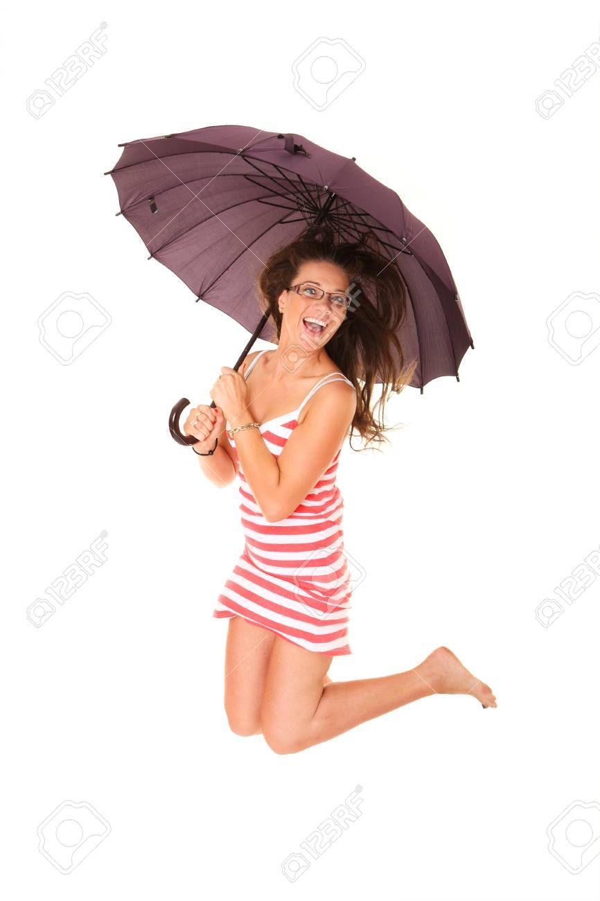A picture of a young positive woman jumping with an umbrella and smiling over white background Stock Photo - 14549106