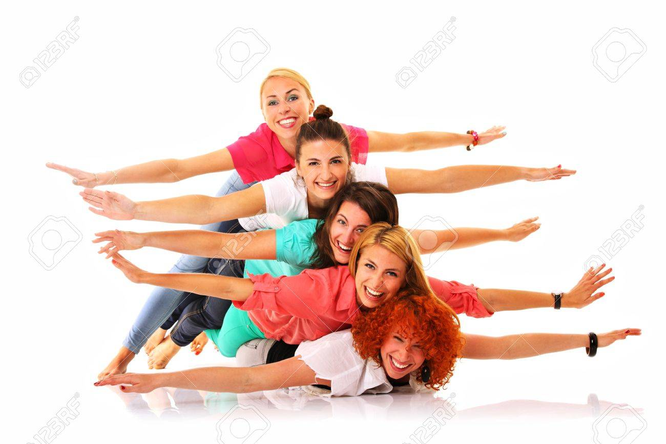 A picture of five joyful girls lying on each other and smiling over white background Stock Photo - 16537343