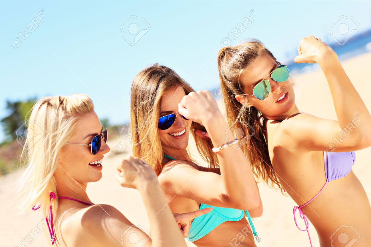 A picture of a group of sexy women showing muscles on the beach Stock Photo - 42869148