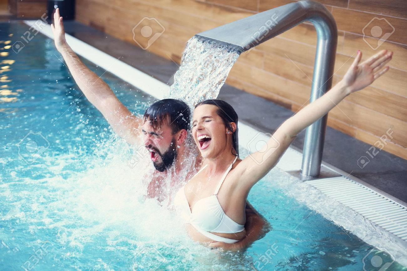Picture of happy couple relaxing in pool spa - 64710890