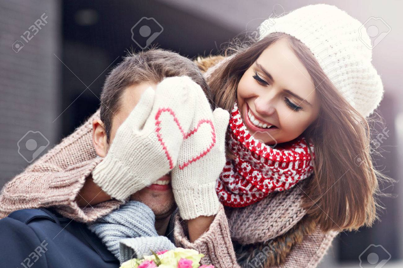 Picture showing young couple with flowers dating in the city - 65626942