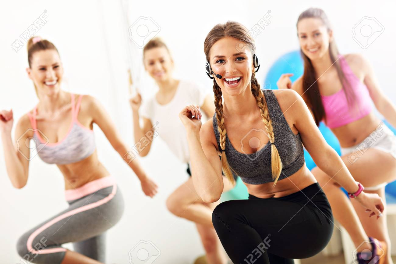 Group of smiling people doing aerobics - 78169056