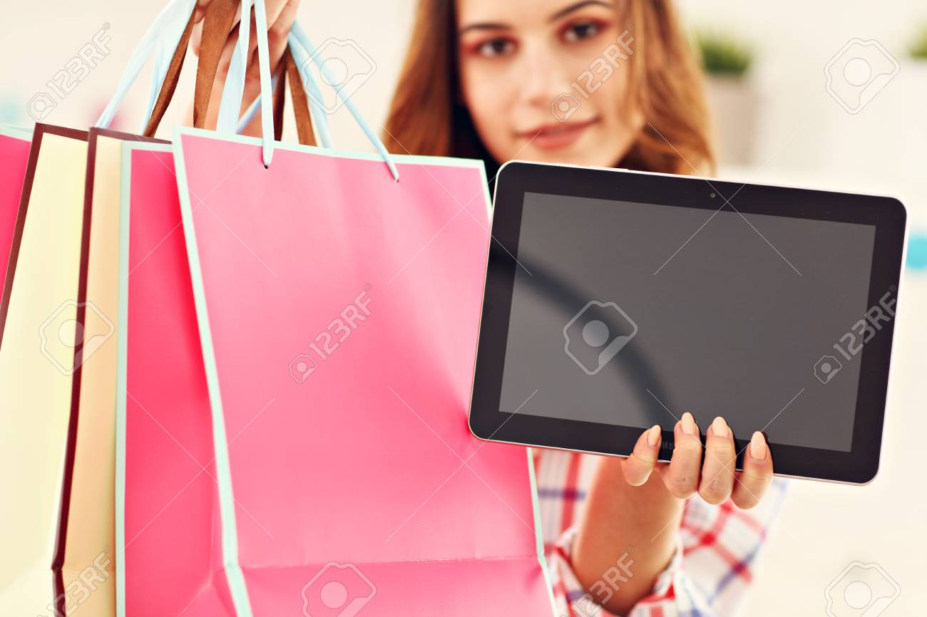 Attractive woman buying easter gifts online stock photo picture and attractive woman buying easter gifts online stock photo 96206717 negle Images