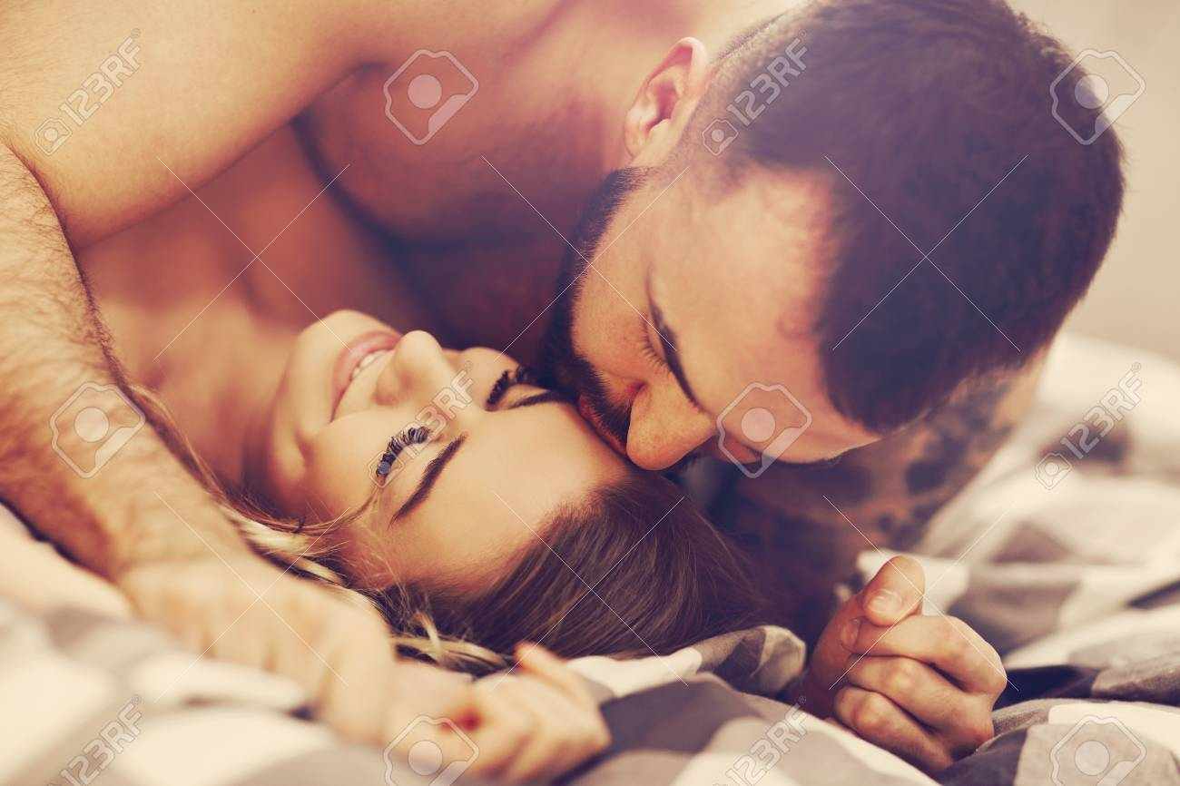 Sexy young lovers being intimate in bed - 97192722