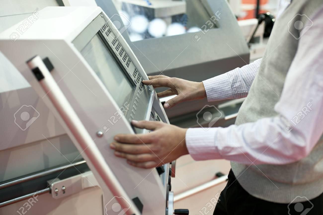 man working at programmable machine Stock Photo - 18823444