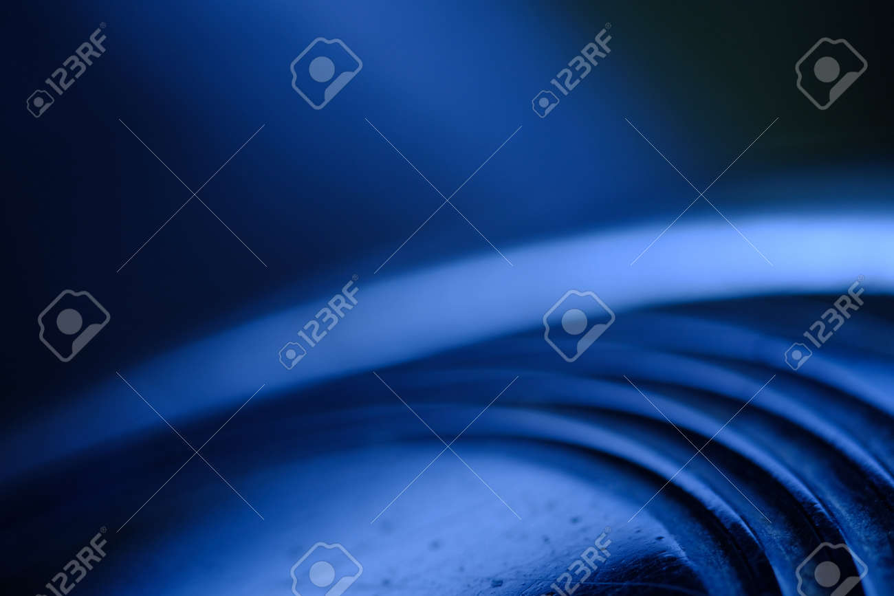 Abstract macro photography. Layered circle texture background with blue light. cold tone color - 167319569