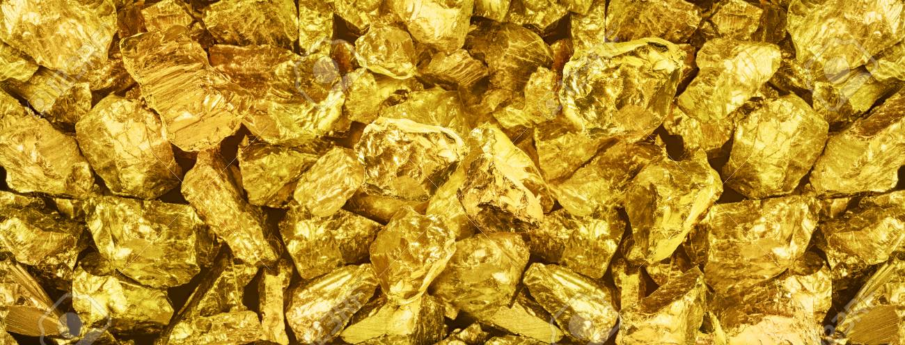 |Big panorama photo of many golden nuggets close-up. Wide background of shiny golden bars. Golden ingot close-up on wide background. - 110303619