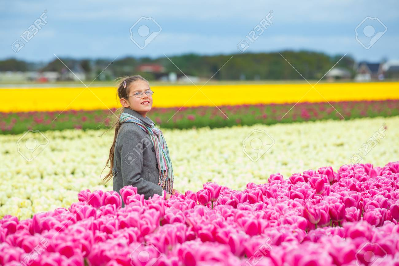 Girl in the colorful tulips field Stock Photo - 14023243