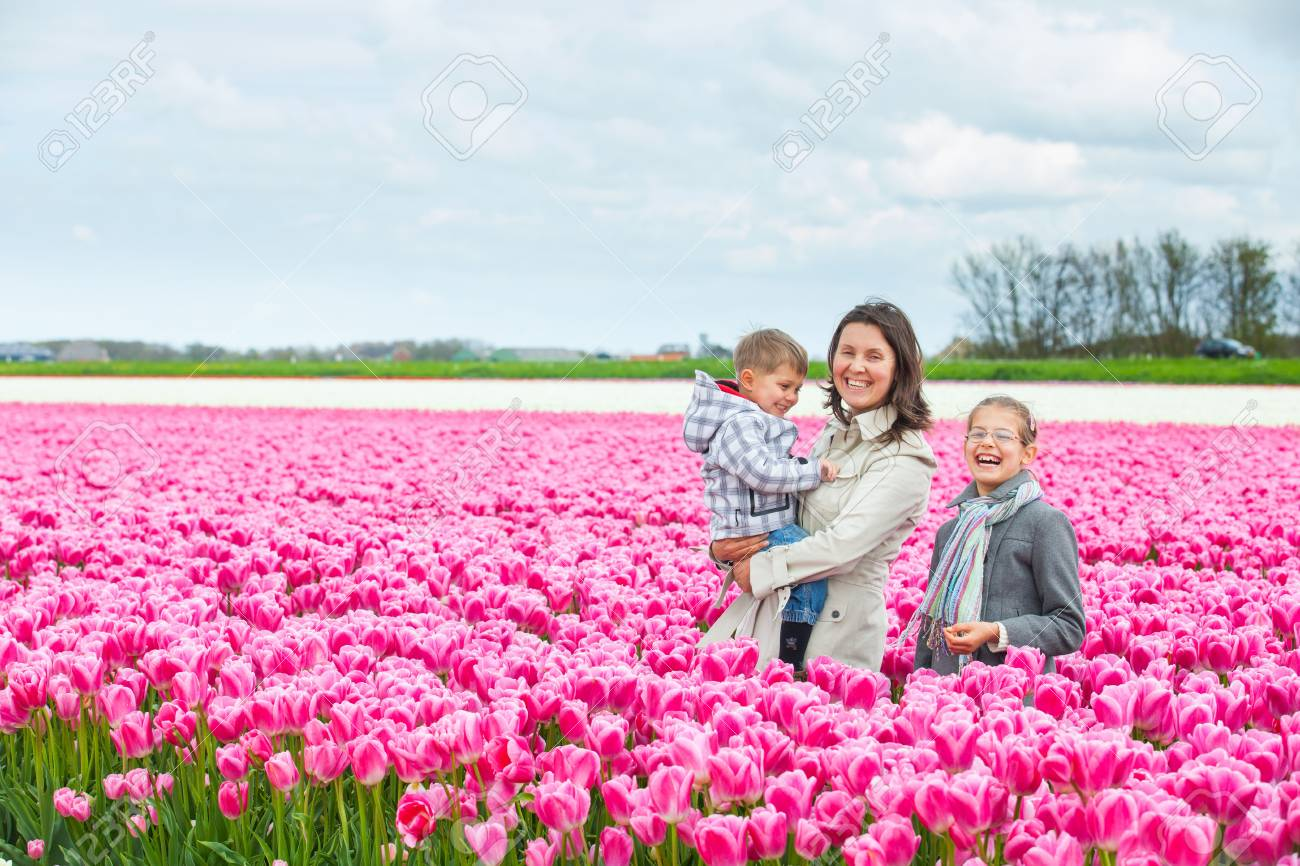 Mother with her child in tulips field Stock Photo - 14023245
