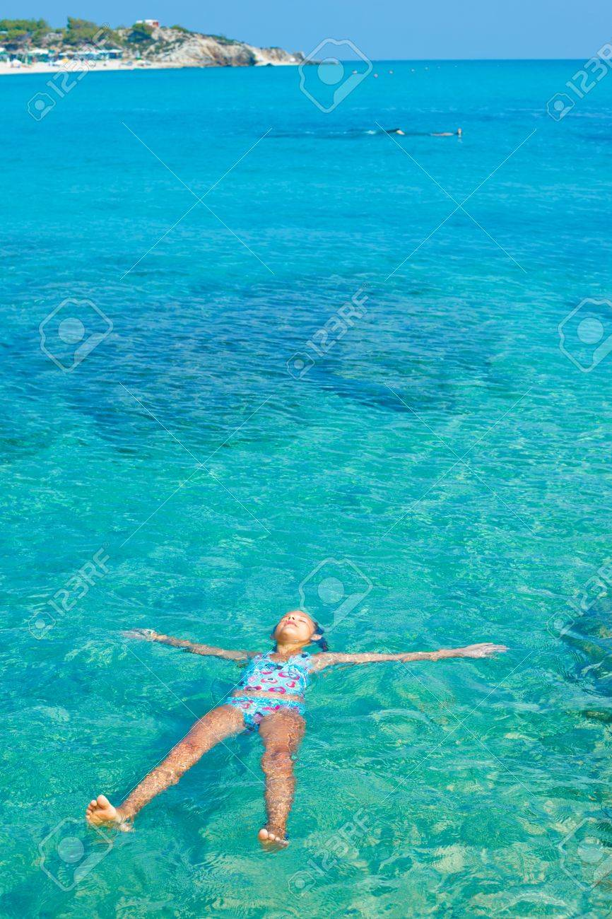 Young girl in the sea Stock Photo - 17107343
