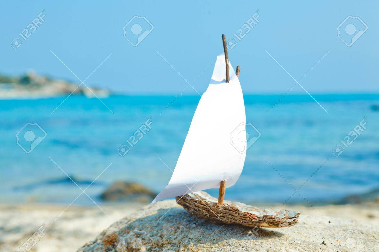 Ship toy model on the beach Stock Photo - 17180516