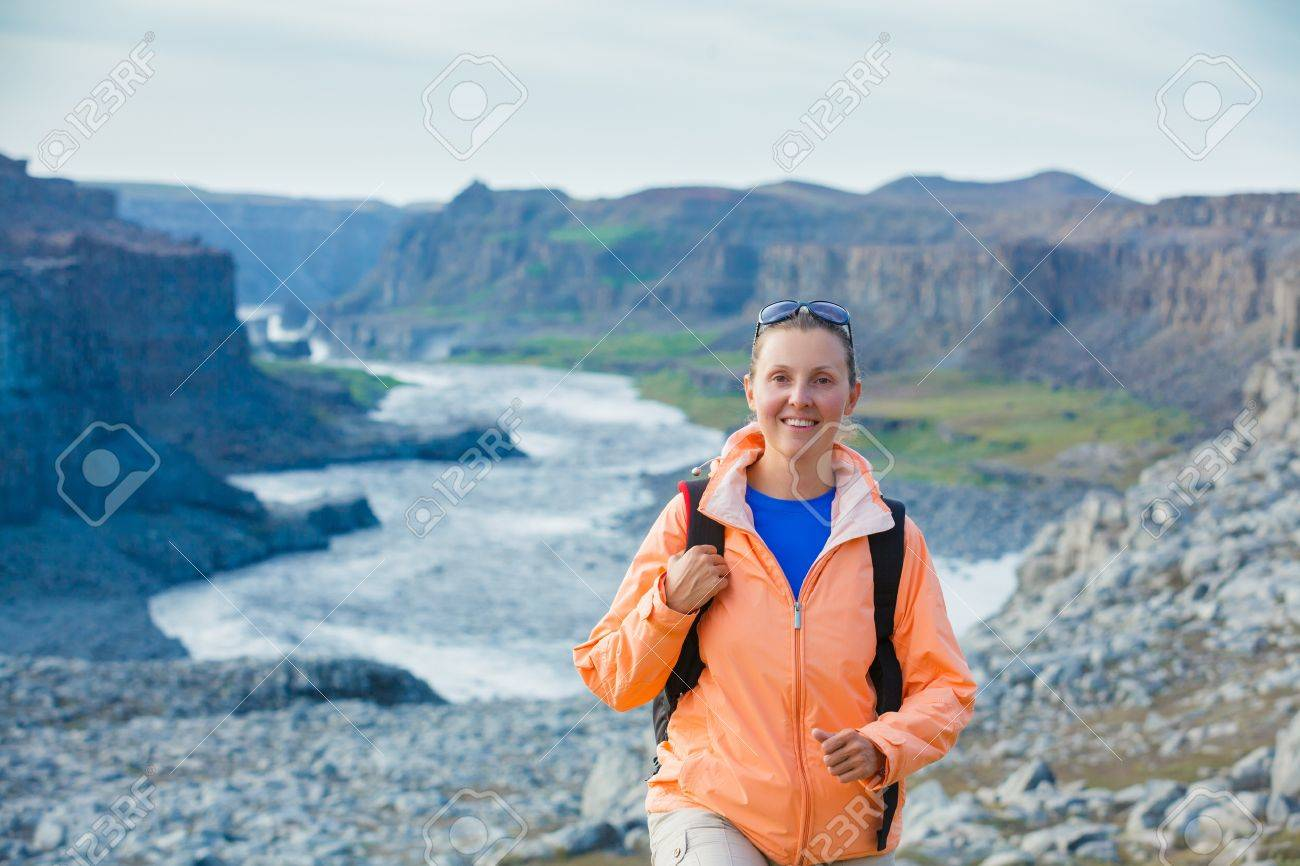 Cute woman hiking in the canyon Dettifoss waterfall in Vatnajokull National Park, Northeast Iceland Stock Photo - 18178580