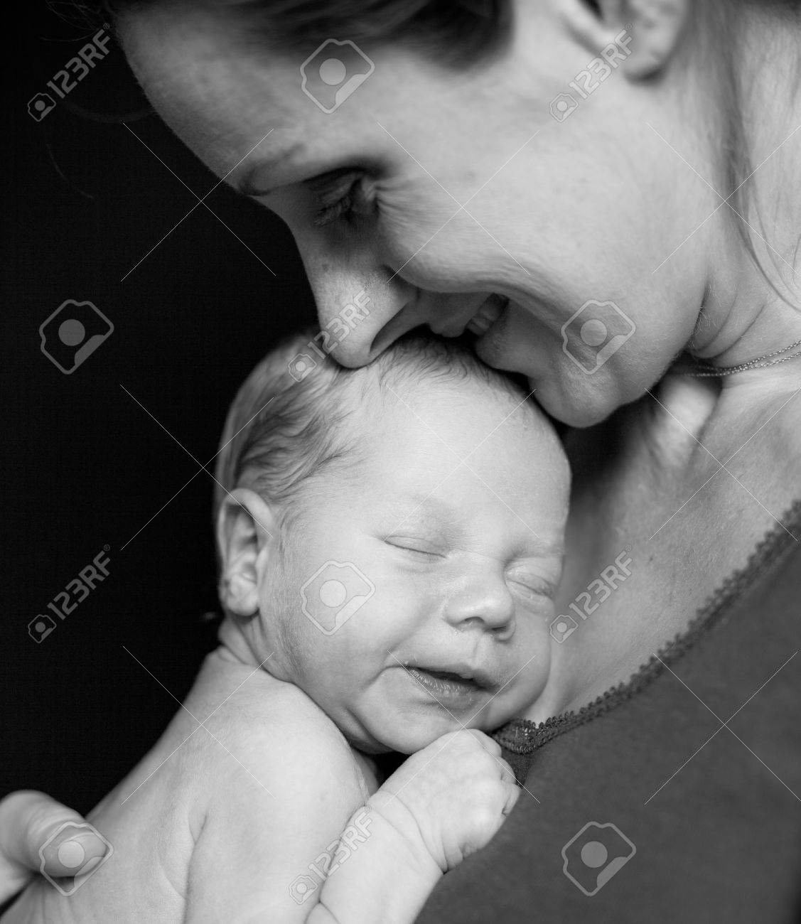 Mother holding tenderly a newborn baby boy, 11 day old Stock Photo - 18282272