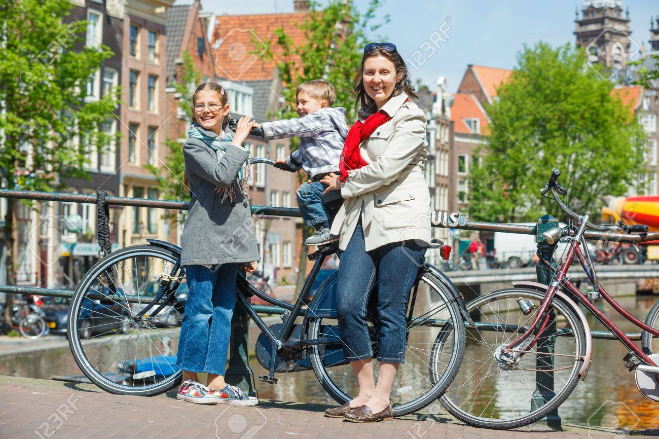 Tourists in Amsterdam  Mother with her kids walking in the streets of Amsterdam  The Netherlands Stock Photo - 18676348