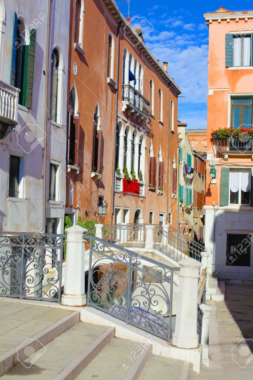 Beautiful romantic Venetian scenery  Street, canal, bridge  Venice  Italy Stock Photo - 19969689