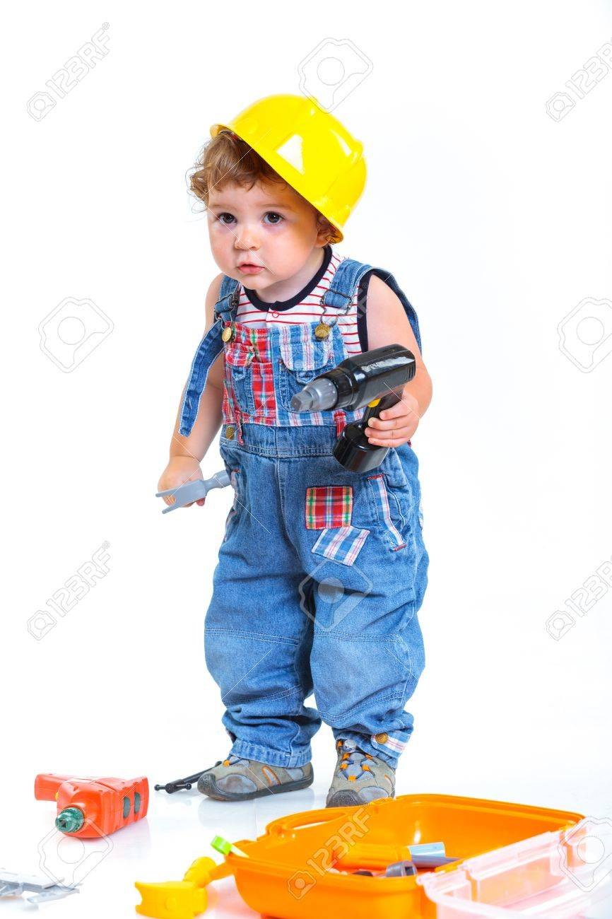 3a132ade906 Little builder Baby boy in a helmet plays in the builder with tools Isolated  over white