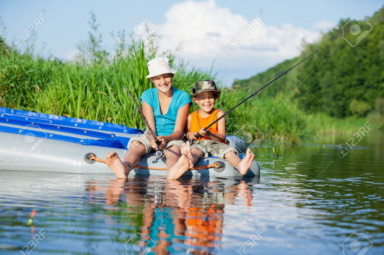 Kids fishing at the river - 36448397