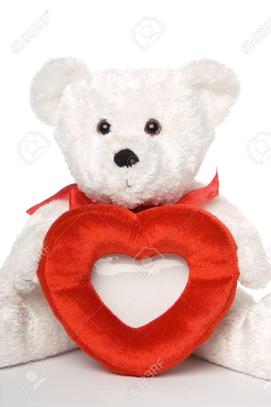 Weiß Teddybär Betrieb Herzförmige Bilderrahmen. Close Up Lizenzfreie ...