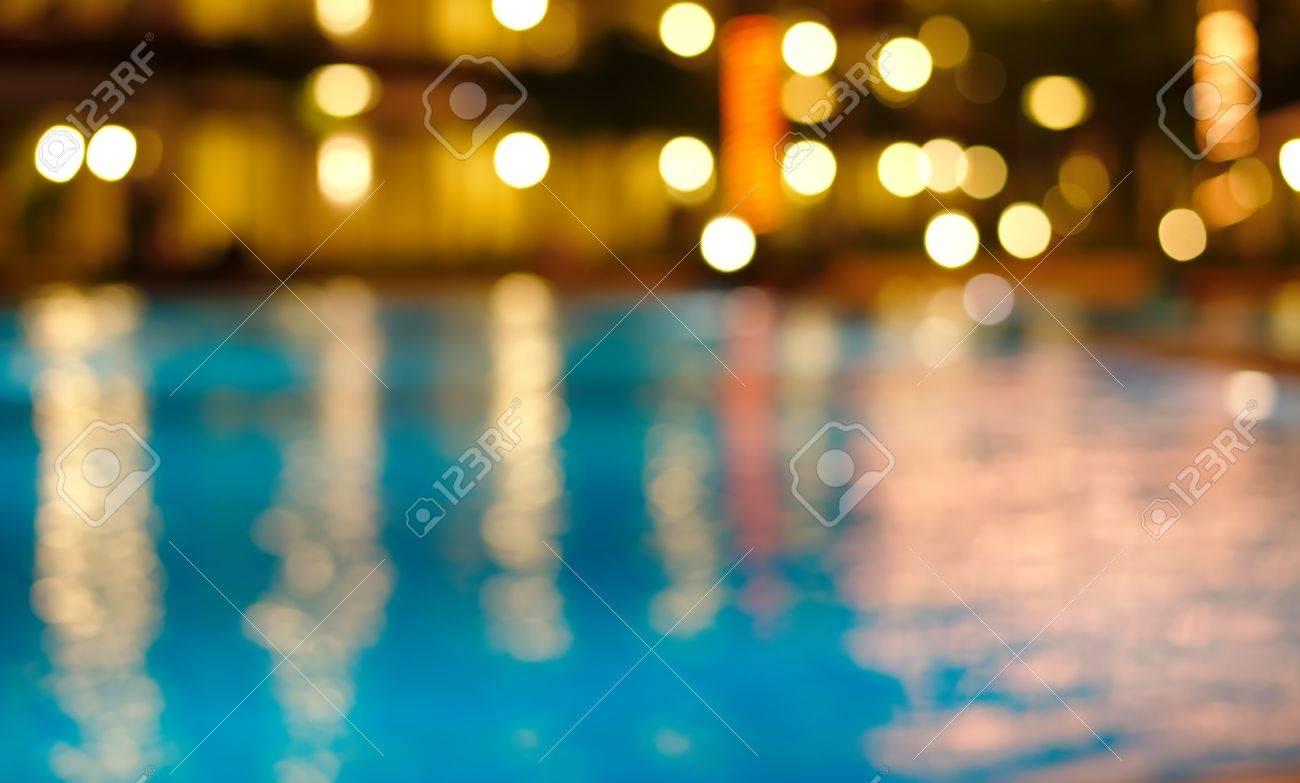 blur night light reflection in blue waving water - 39101661