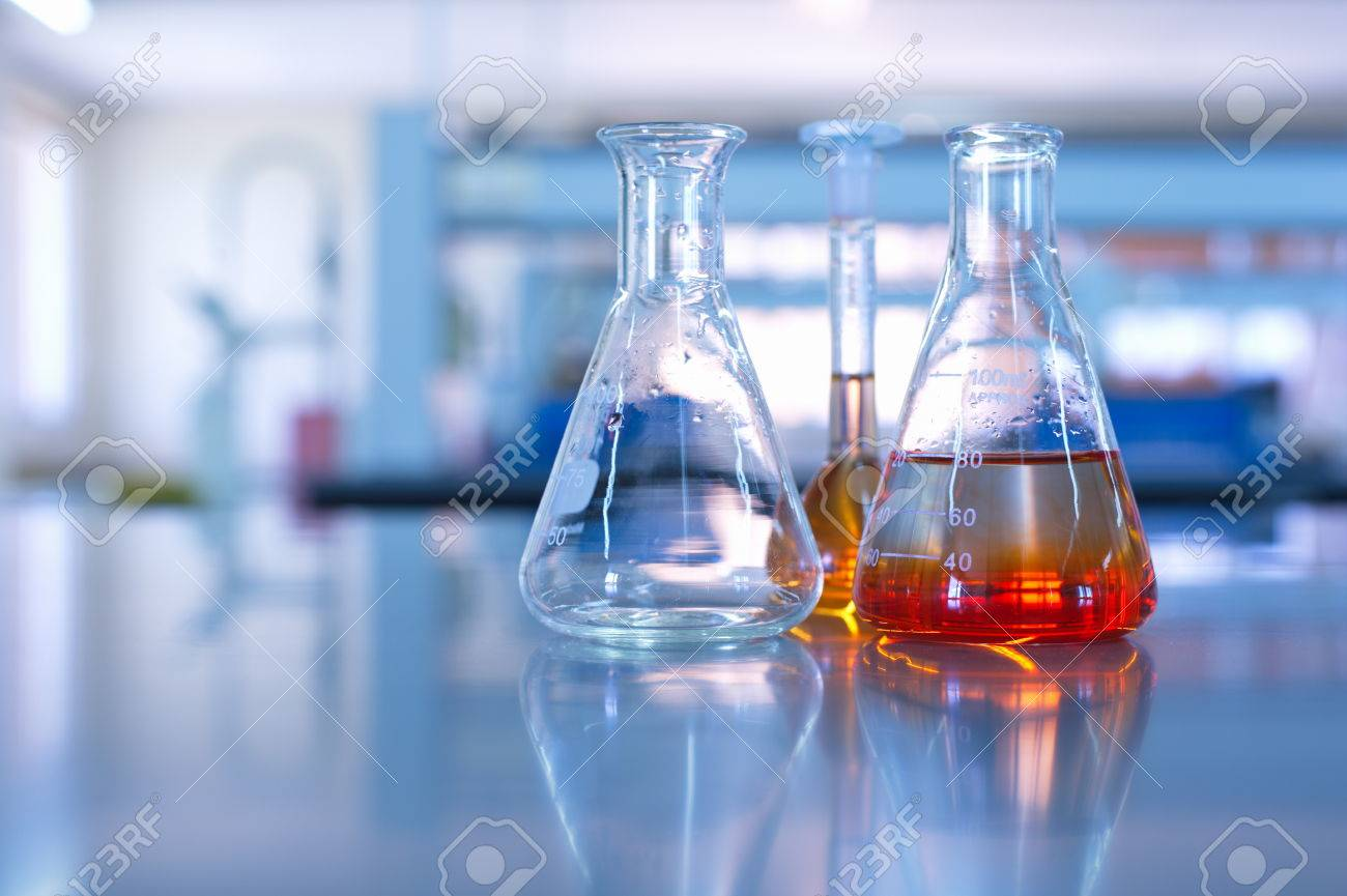 science laboratory glassware orange solution - 44930309