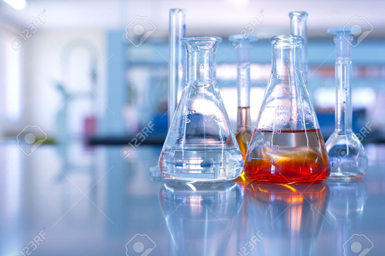 science laboratory glassware orange solution - 44930313