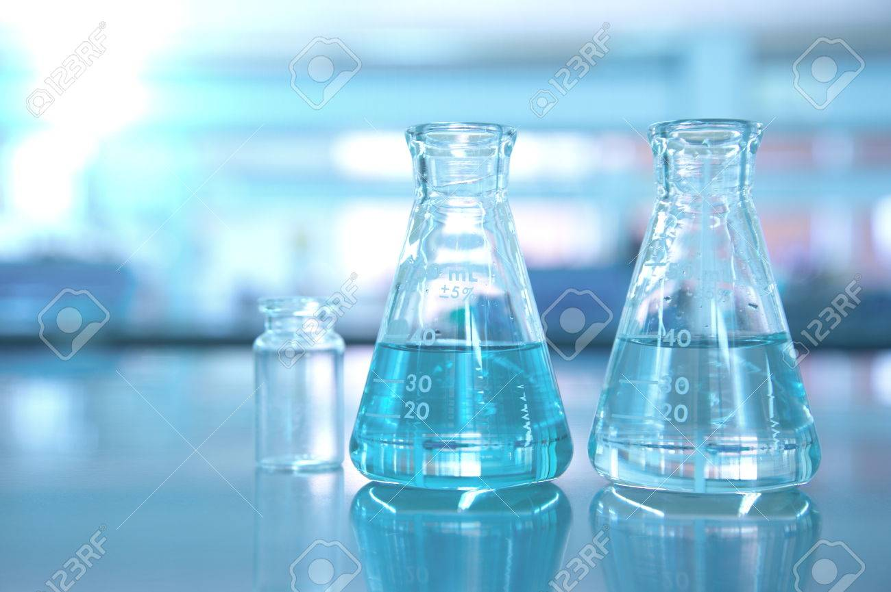 two blue flask in science lab background - 68428573