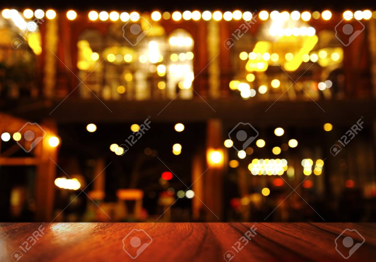 top of wood table with lamp light of bar or night club resturant party background - 90736923