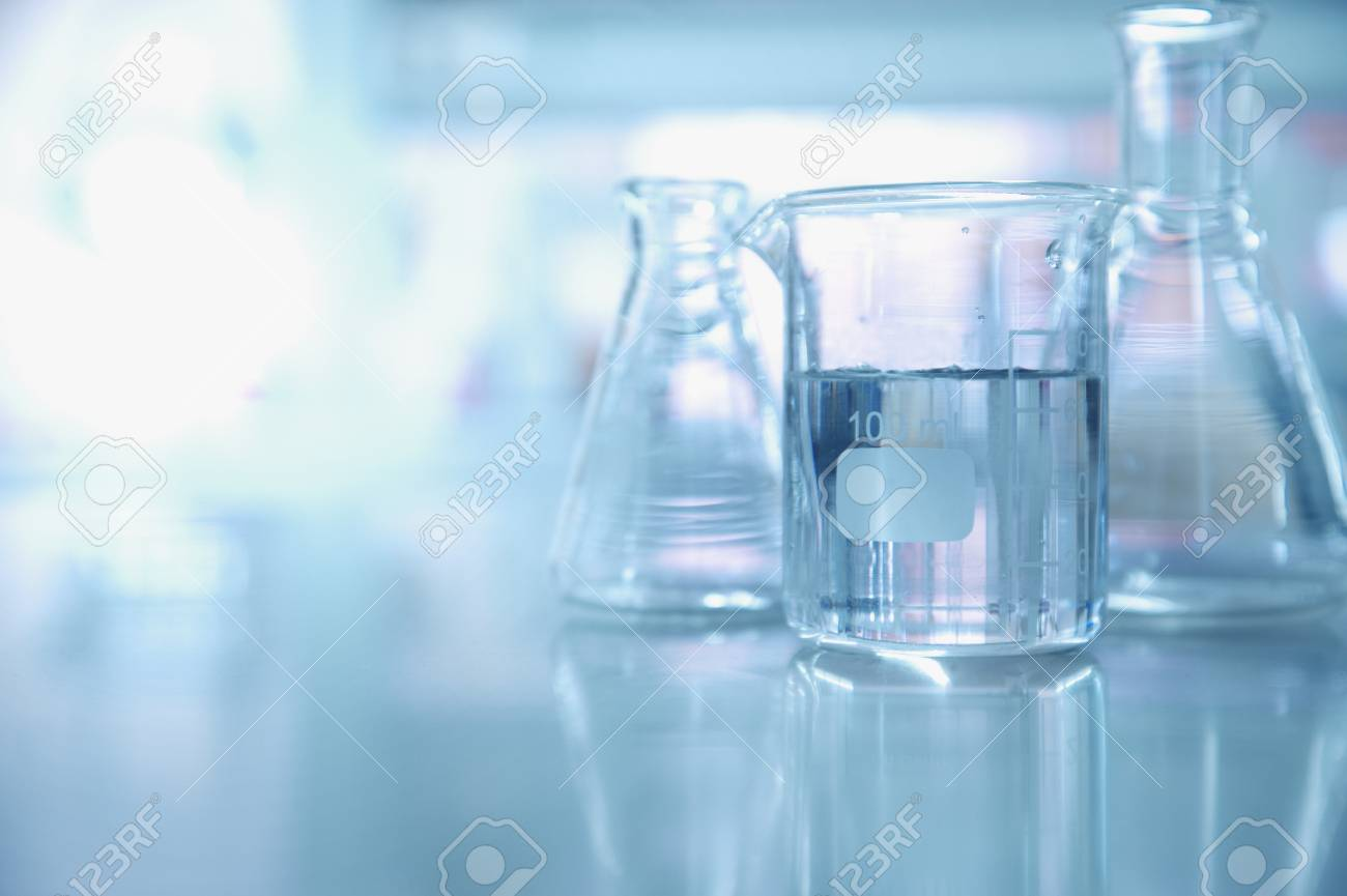 experiment water in beaker and flask in blue chemistry science laboratory background - 91653629