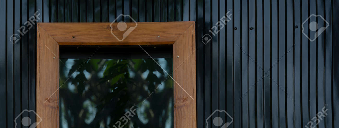 dark black metal wall with glass window with wood frame architecture banner background - 172410092