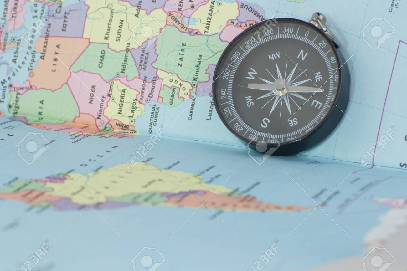 Map Of The World With Compass.We Can Travel Around The World With Compass And Map Only Stock Photo