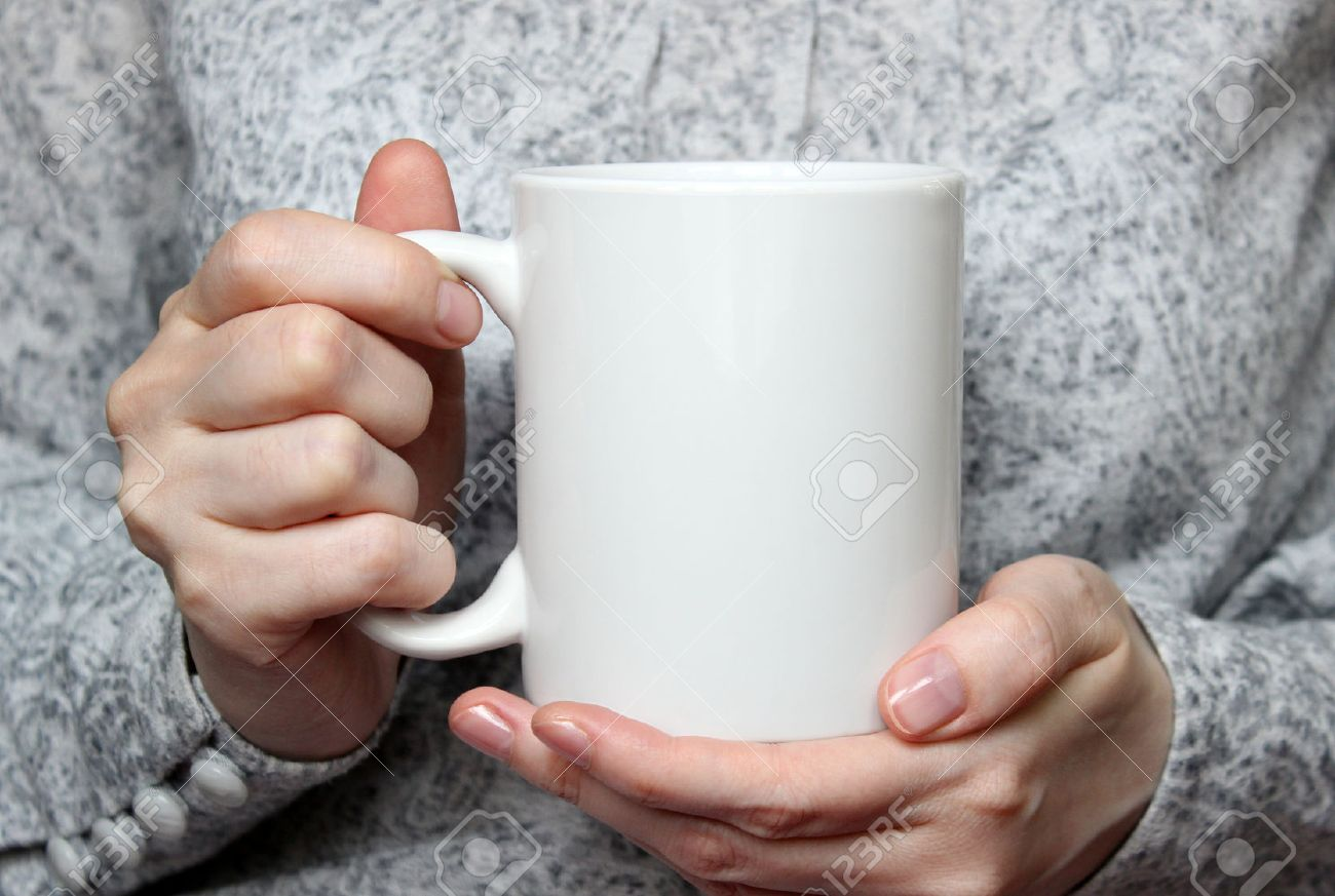 girl is holding white cup in hands white mug in woman s hands