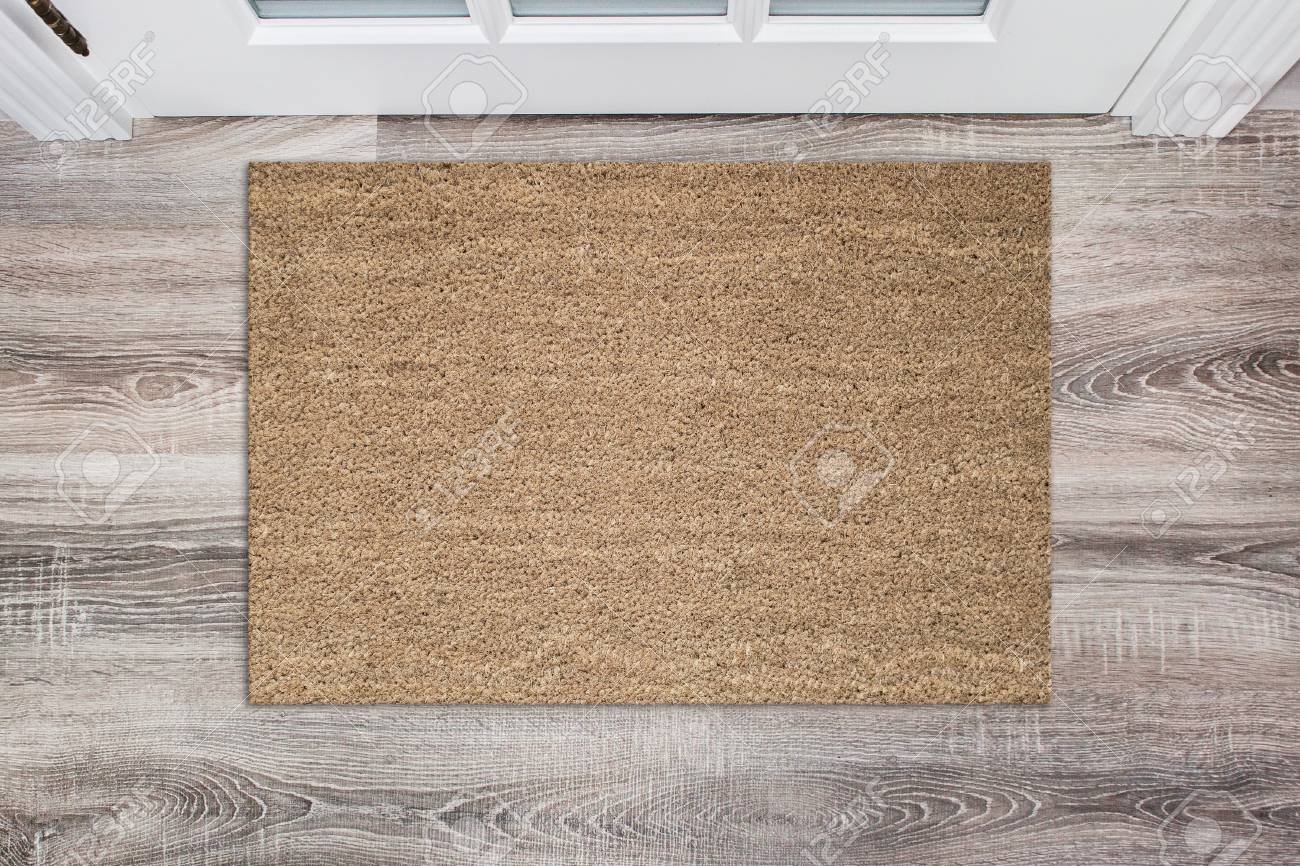 Blank Tan Colored Coir Doormat Before The White Door In The Hall. Mat On  Wooden