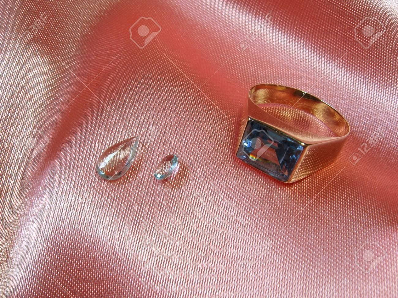 An Aquamarine Gold Ring With Two Gems On Pink Satin. Stock Photo ...