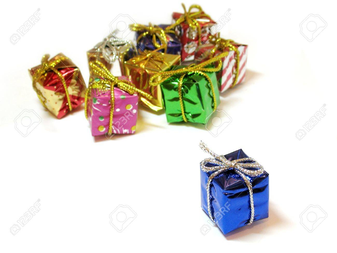 Colorful decorative mini gift boxes on white background, one focused in the foreground, the others unfocused in the background Stock Photo - 622723
