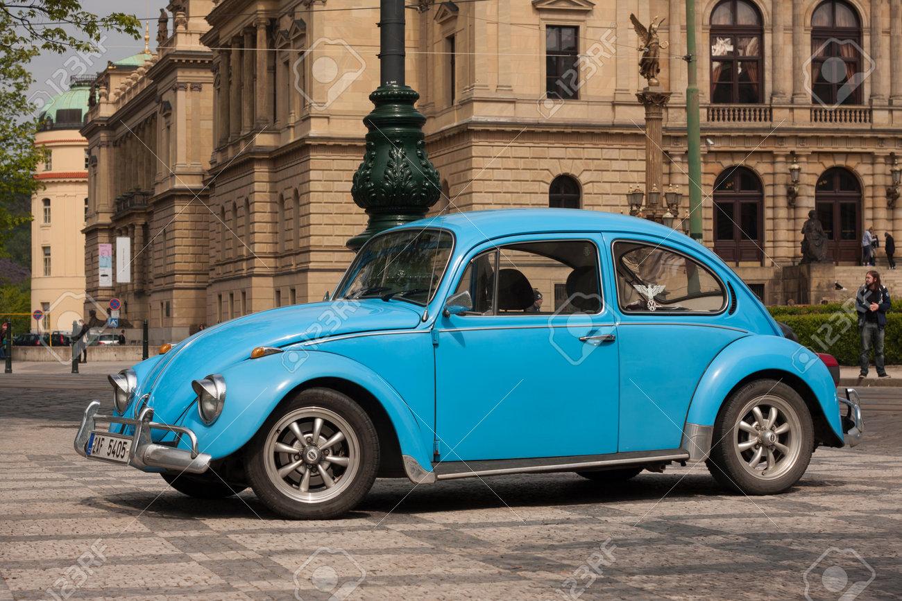 PRAGUE, CZECH REPUBLIC - APRIL 21, 2017: Vintage blue Volkswagen Beetle car, parked in front of the Rudolfinum concert hall - 78382932