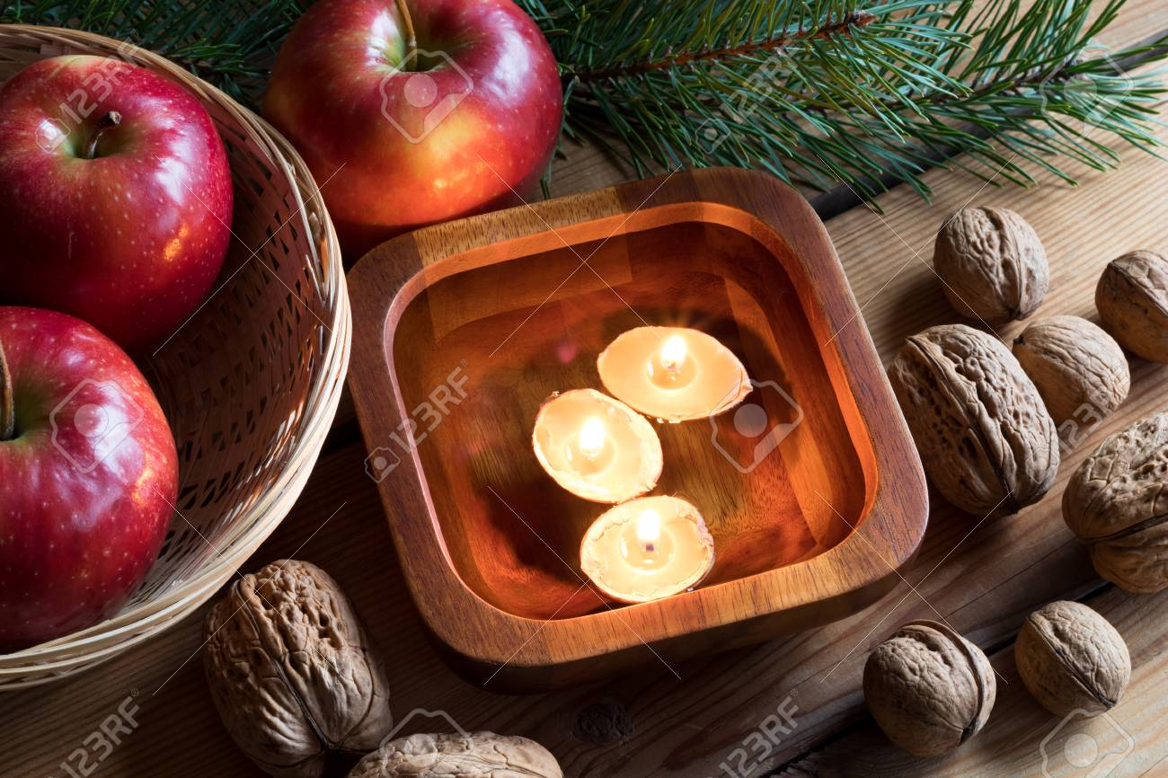 Christmas Floating Candles.Christmas Decoration Apples Pine Branches Walnuts And Floating