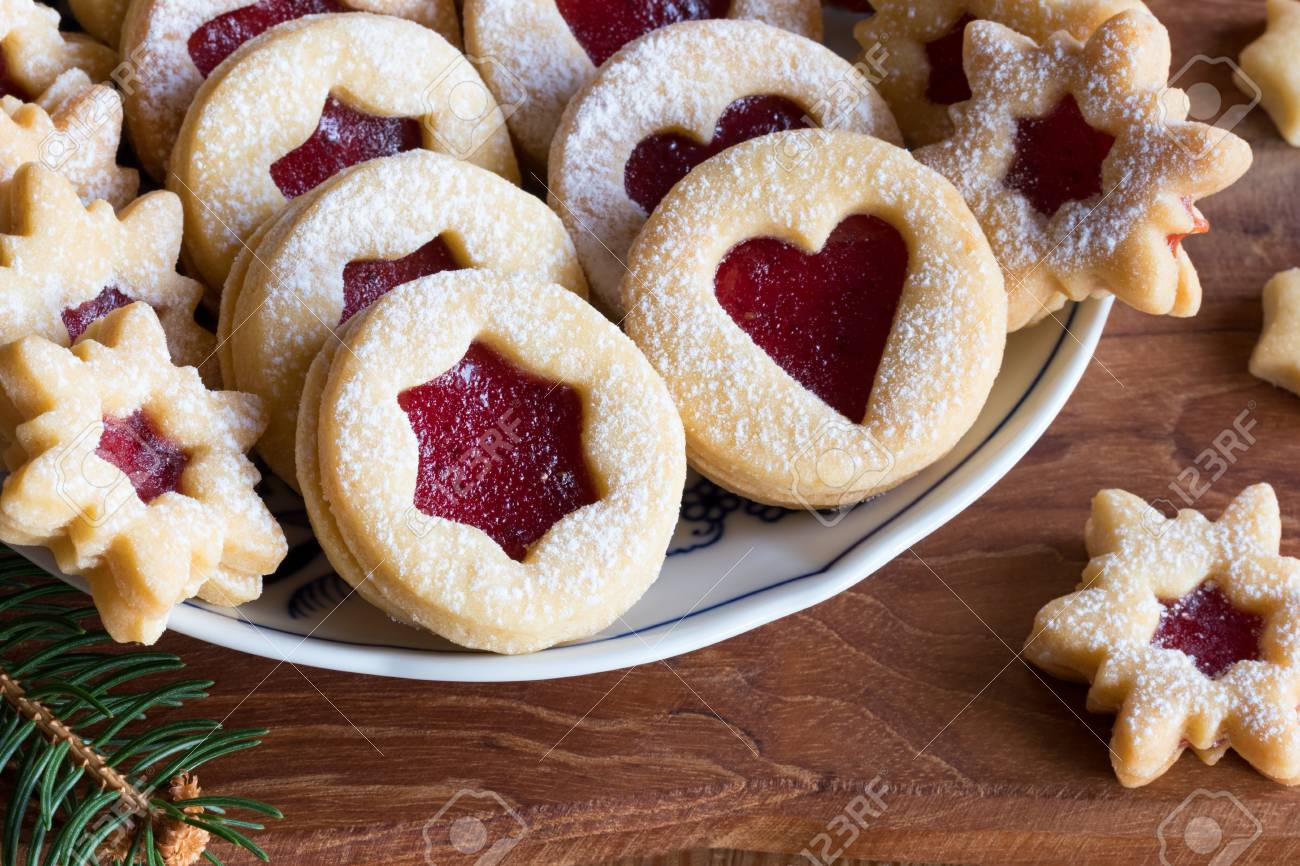 Linzer Christmas Cookies Filled With Strawberry Jam And Dusted Stock Photo Picture And Royalty Free Image Image 93413310