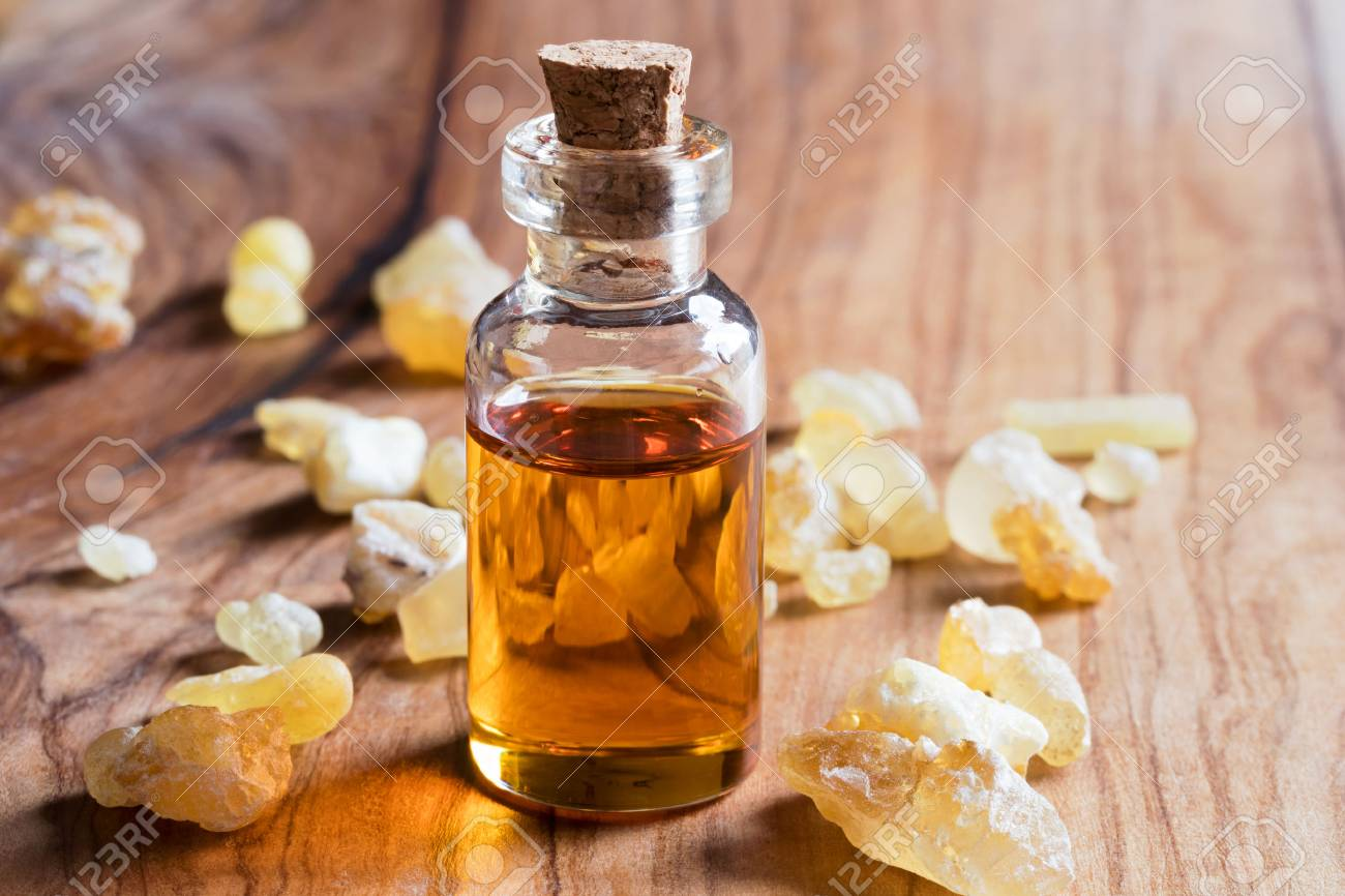 A bottle of frankincense essential oil with frankincense resin crystals - 94765940