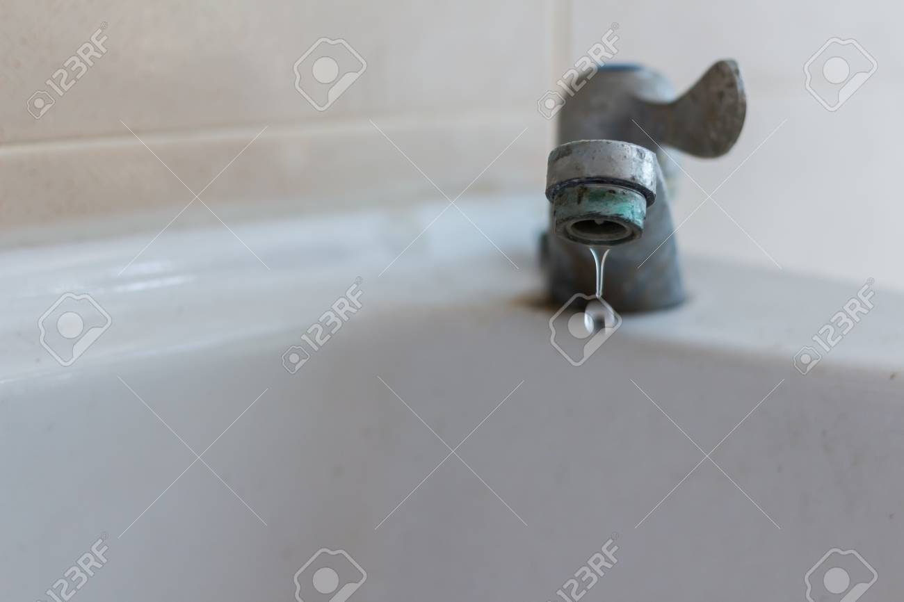 Soft Focus Defective Faucet. Cause Wastage Of Water. Old Rusty ...