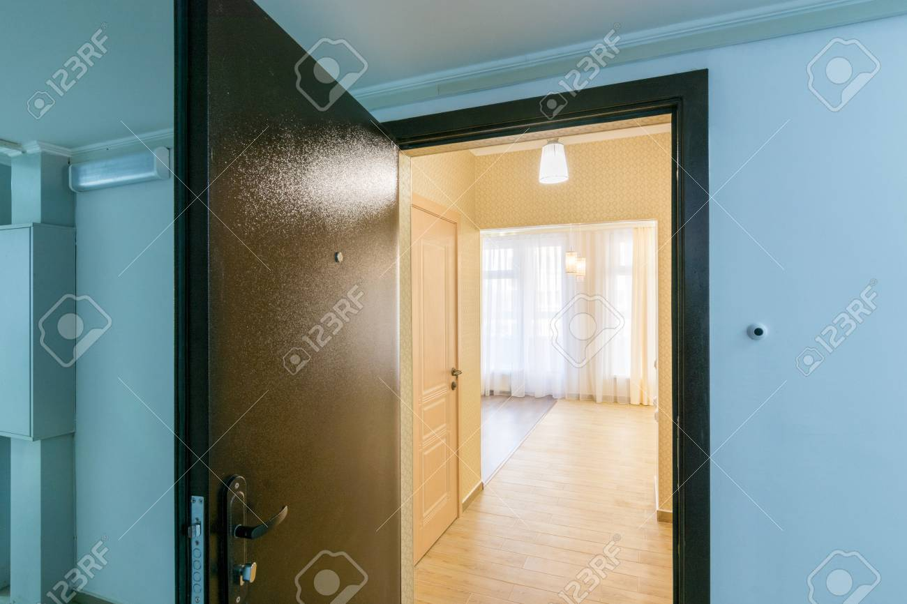 Stock Photo   The Open Front Door In Renovated Apartment In New Building