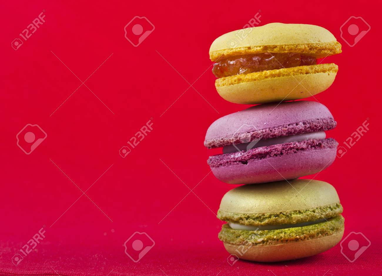 Border of Colorful macaroons on a red background Stock Photo - 18374788