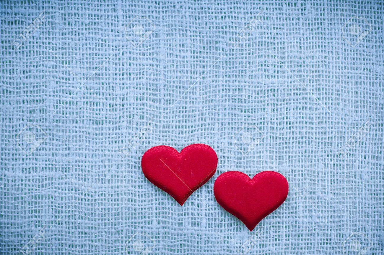 Valentine s day card, red heart symbol on fabric sack texture background Stock Photo - 18938793