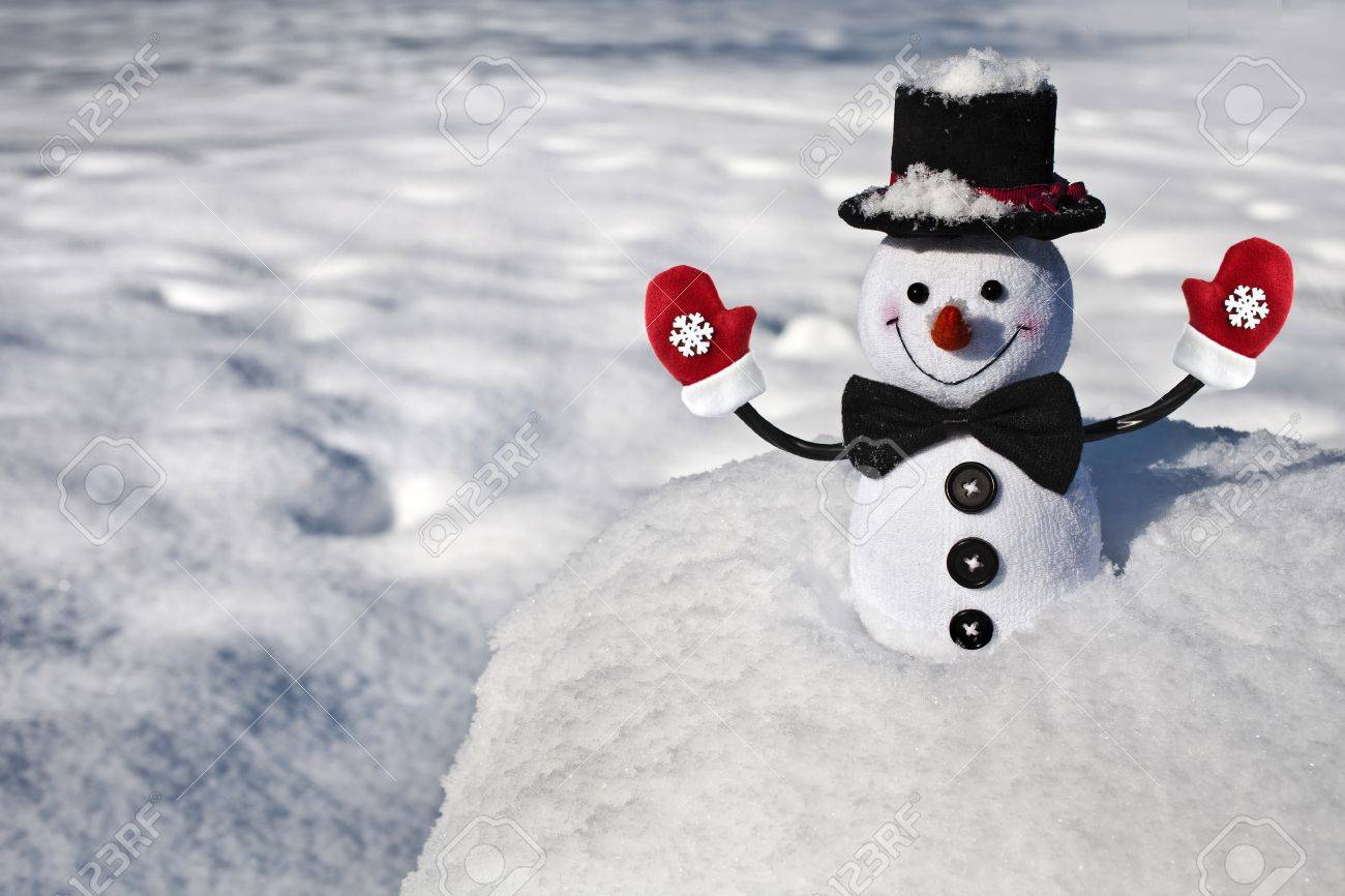 Happy Christmas Snowman With Black Hat And Mittens In Snowy Ball Stock Photo