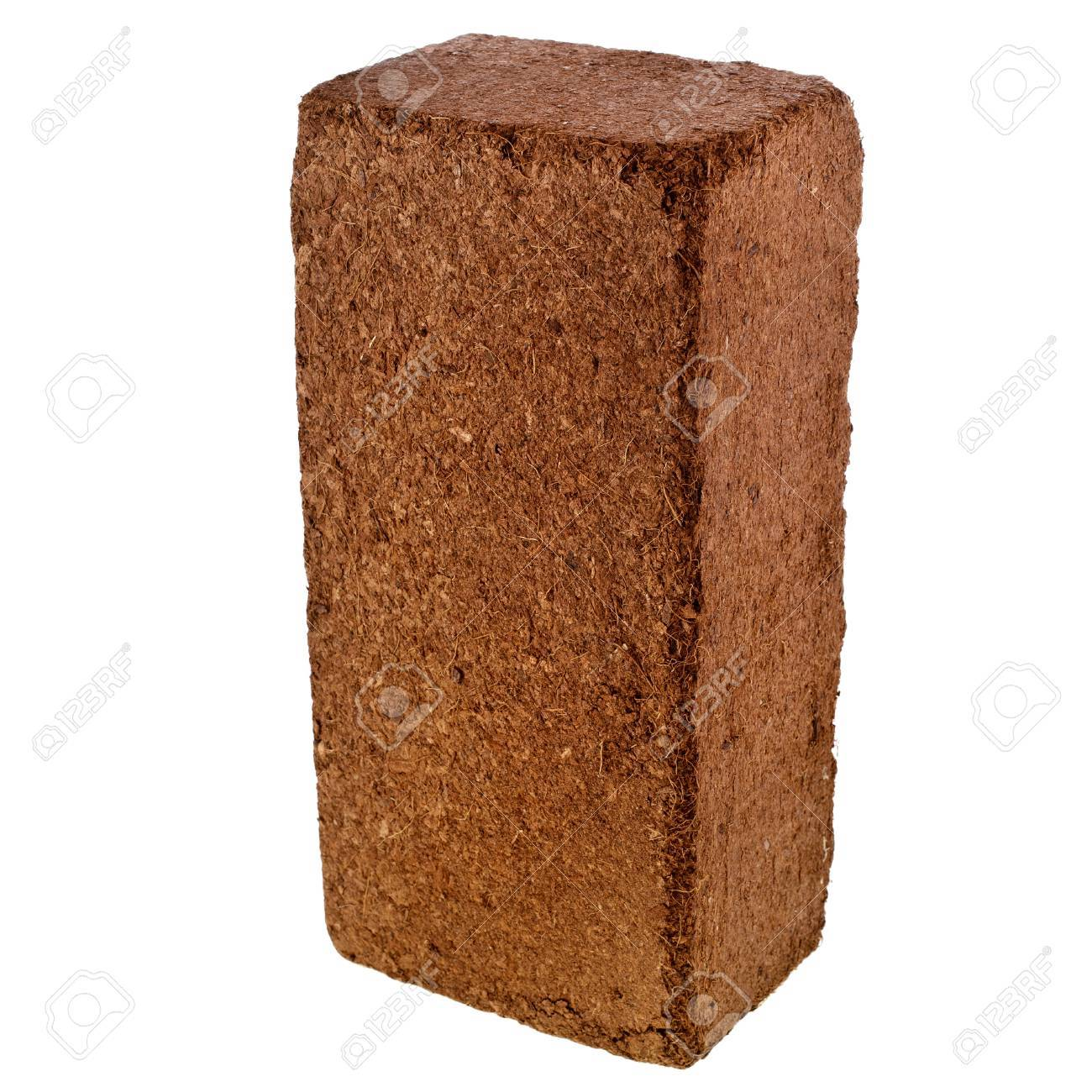 A compressed bale of ground coconut shell fibers  coir , surface background Stock Photo - 21365764