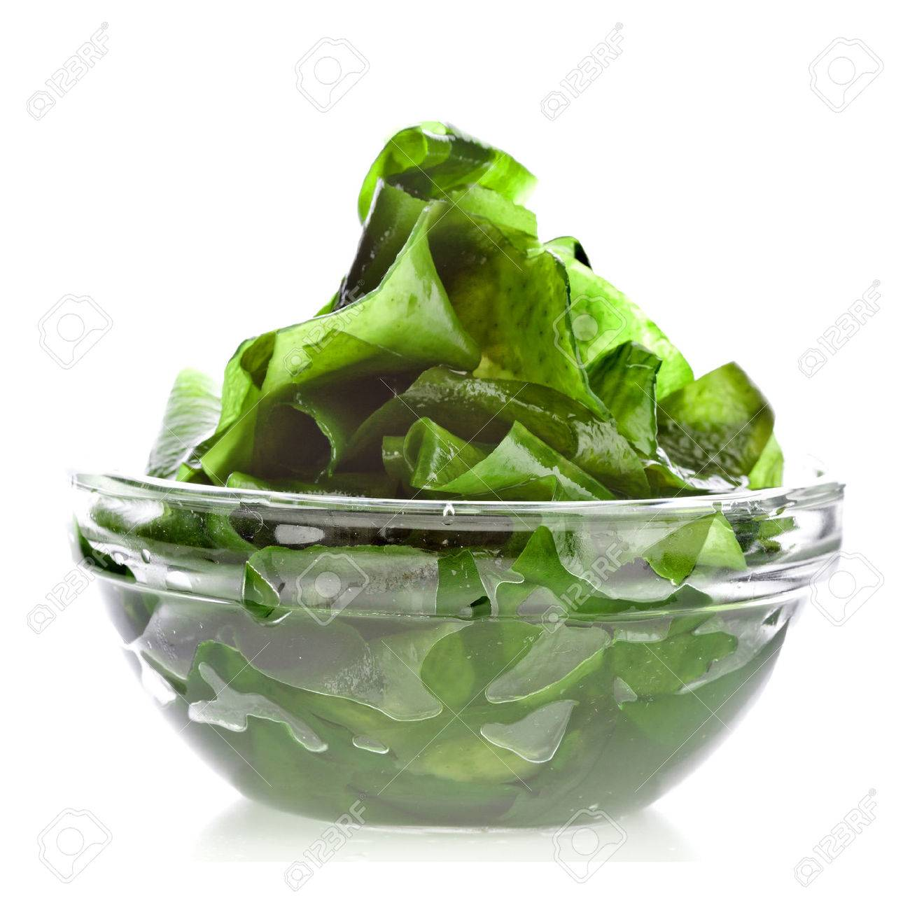 seaweed kelp laminaria in glass bowl close up isolated on white background - 24397407